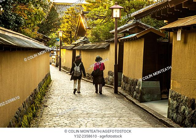 Japanese women stroll through historic quarter of narrow lanes, boutique craft shops, Kanazawa, Japan