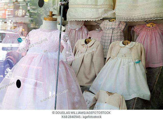 Communion dresses in a shop window in Mexico City, Mexico