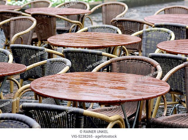 GERMANY, BONN, 02.04.2015, DEU , GERMANY : Tables of a cafe in the rain - Bonn, Northrhine-Westfalia, Germany, 02/04/2015