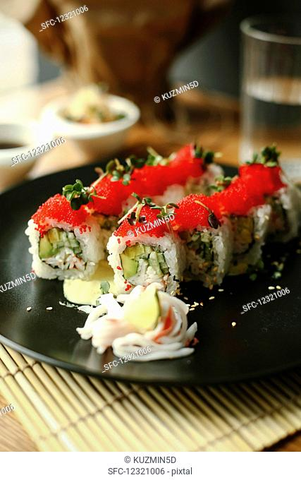 Sushi rolls with cucumber and flying fish roe