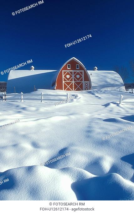 Vermont, red barn, farm, VT, Snow-covered red barn with white trim at Diamond Heart Farm in East Albany in the winter