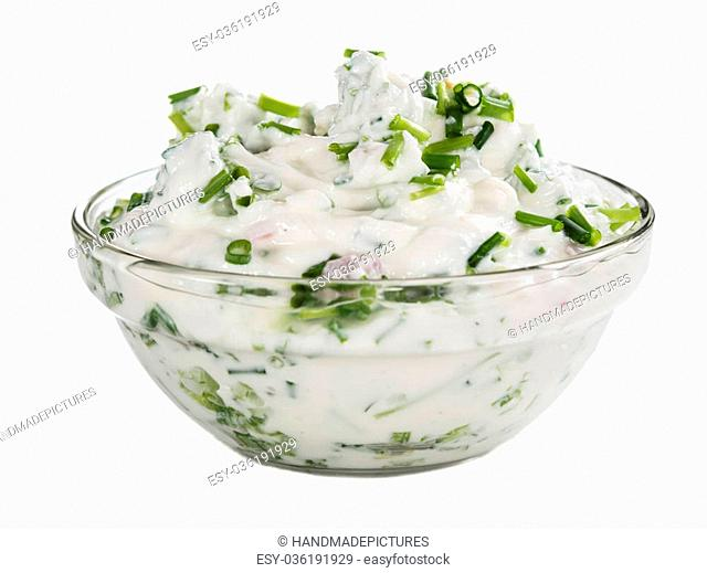 Bowl with fresh made Herb Curd isolated on white background