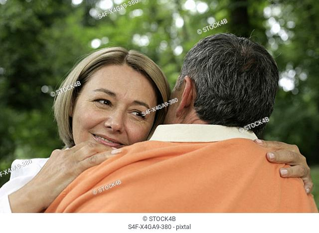 Mature couple embracing each other