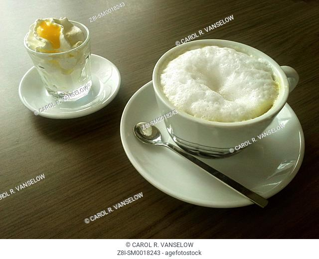 In Limburg, most cafes serve your cappuccino with a little whipped cream and a dollop of Advocaat (a liquer made from eggs)