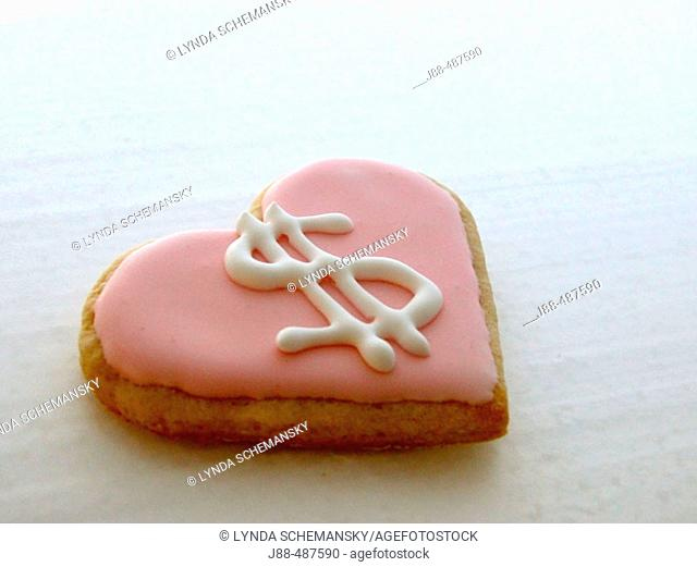 Heart shaped cookie with dollar symbol icing