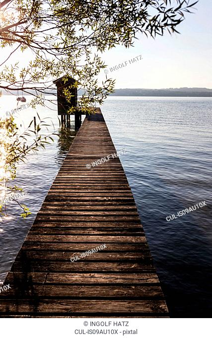 Diminishing perspective of boathouse and pier at lake, Schondorf, Ammersee, Bavaria, Germany