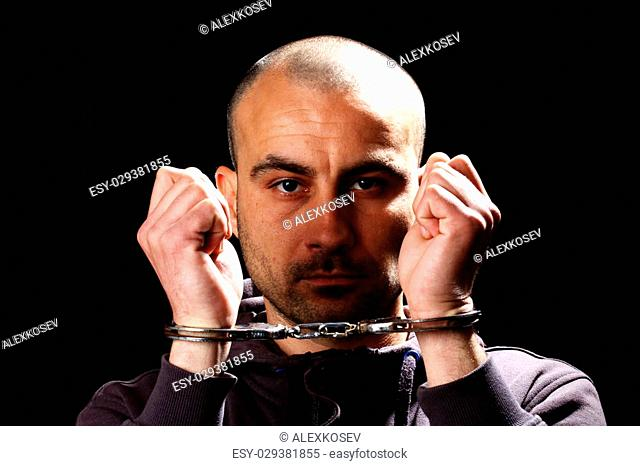 Portrait of a man with handcuffs