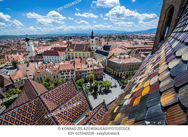 Aerial view from Saint Mary Lutheran Cathedral in Sibiu city in Romania with Council Tower and Holy Trinity Roman-Catholic Church