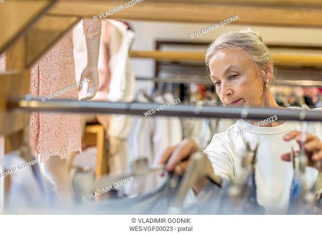 Senior woman shopping for clothes in a boutique