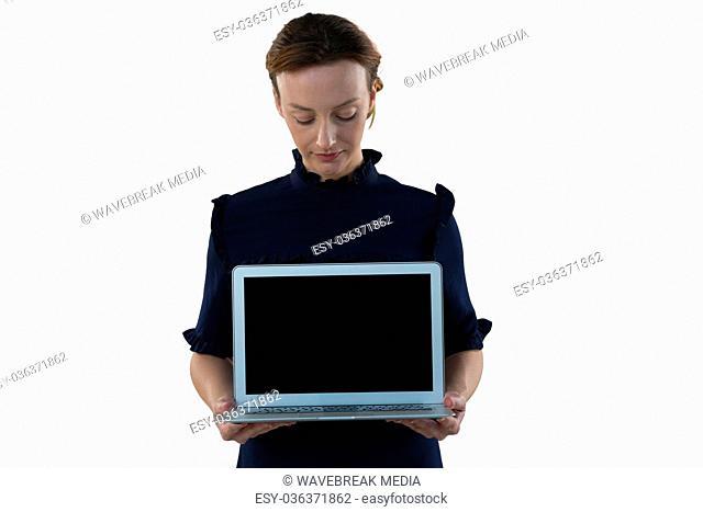 Female executive holding laptop
