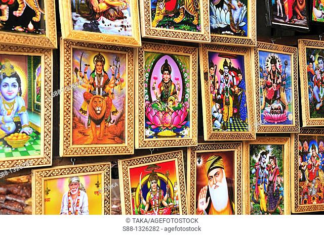 Religious Gods paintings at the shop, Delhi India