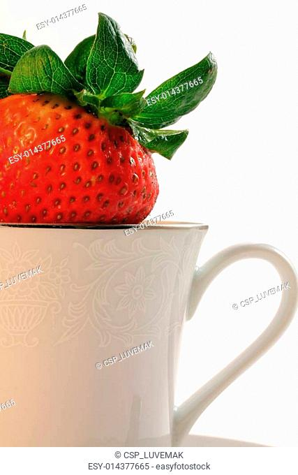 Fresh Red Strawberries inside a White China Teacup