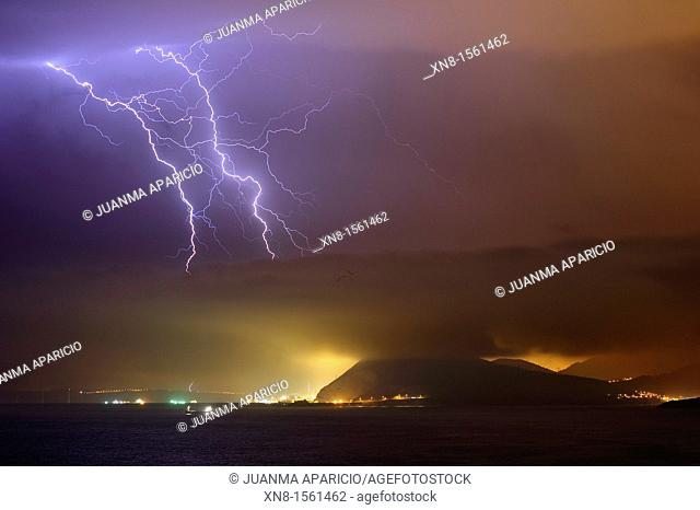 Night photography of a thunderstorm in the Port of Bilbao