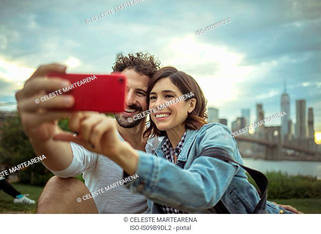 Couple taking selfie, Brooklyn, New York, US