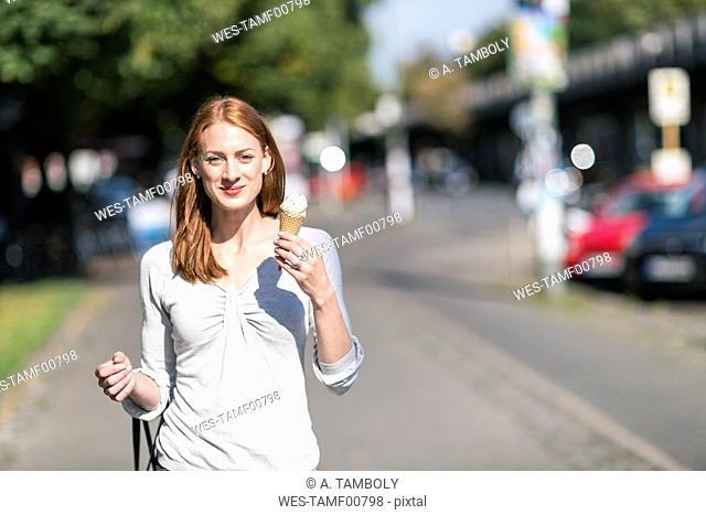 Portrait of smiling woman eating icecream