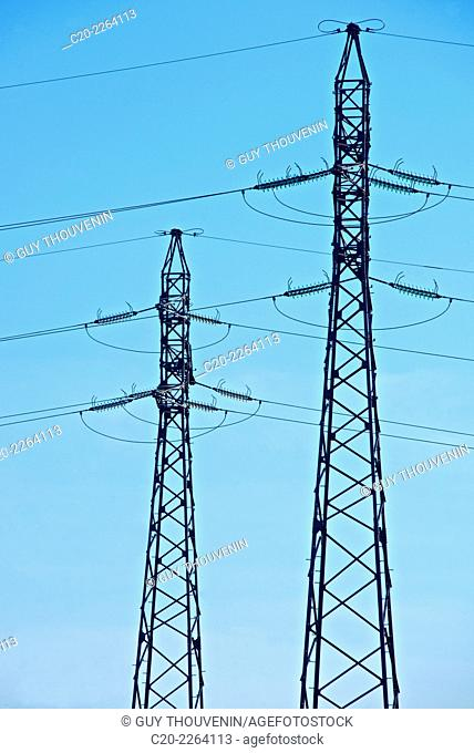 electrical pylons on a blue sky