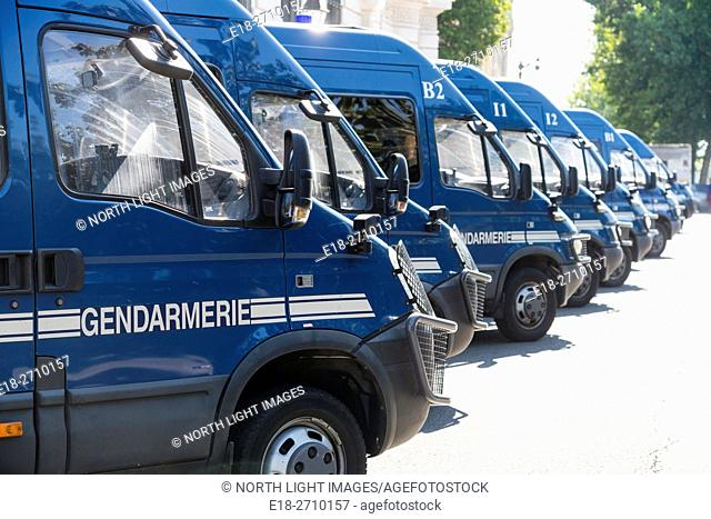 France, Paris. Line of police vehicles. Side view