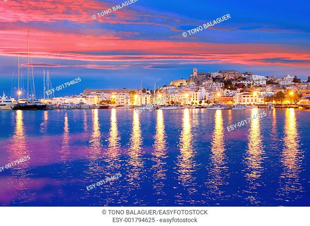 Ibiza island night view of Eivissa town and sea lights reflection
