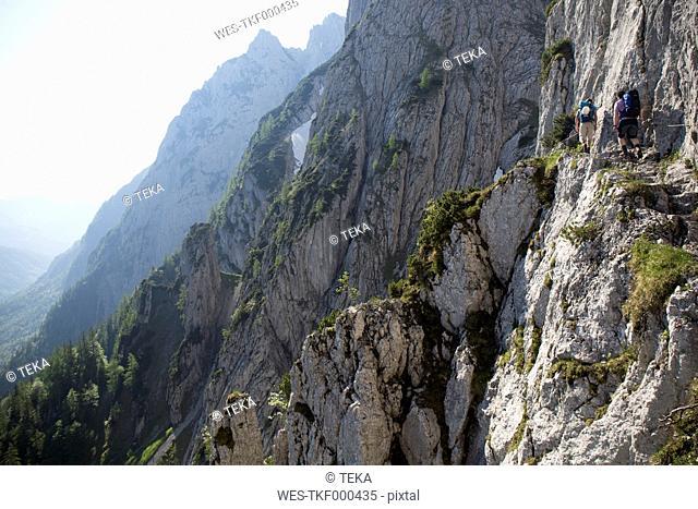 Austria, Tyrol, Wilder Kaiser, two men on via ferrata towards Goinger Halt