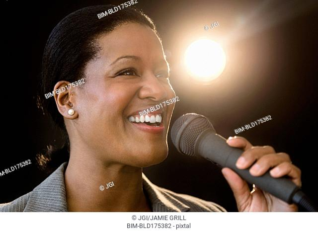 Black businesswoman talking into microphone