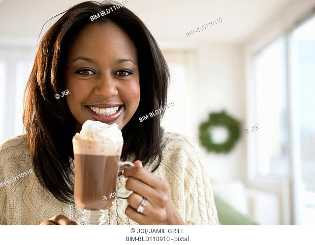 African American woman drinking hot chocolate