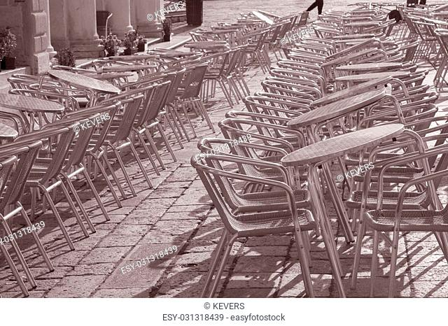 Cafe Table and Chairs in St Marks Square; Venice; Italy in Black and White Sepia Tone