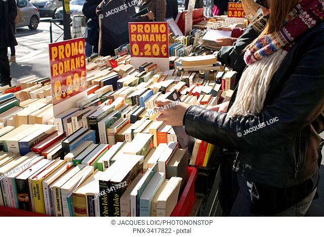 France, Paris, Boulevard Saint-Michel, special offers on books, stalls on the sidewalk