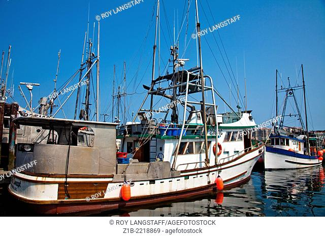 Commercial fish boats at a wharf in Victoria, British Columbia, Canada