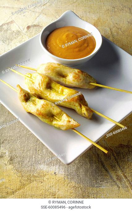 Chicken brochettes with satay sauce