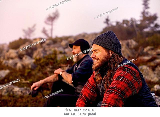 Hikers enjoying view on rocky field, Sarkitunturi, Lapland, Finland