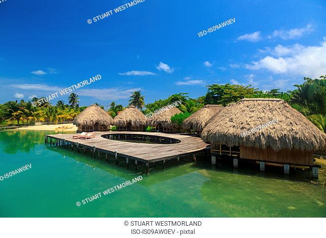 Stilted waterfront chalets and boardwalk, St. Georges Caye, Belize, Central America