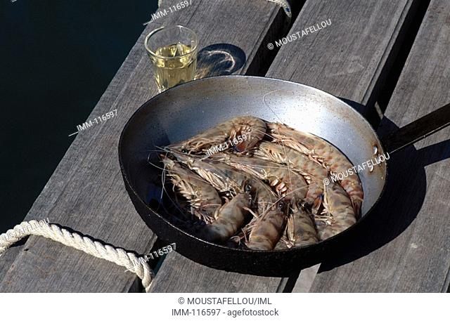Kefallonia, Robola Wine Region Argostoli region, seaside taverna, shrimp and a glass of Robola
