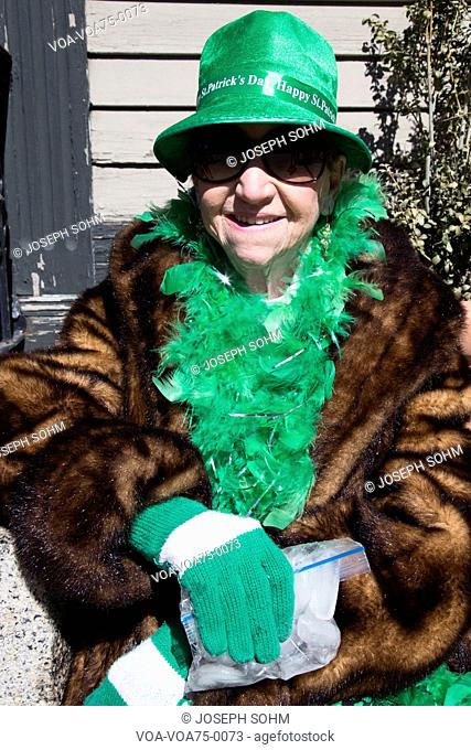 Older woman in green, St. Patrick's Day Parade, 2014, South Boston, Massachusetts, USA