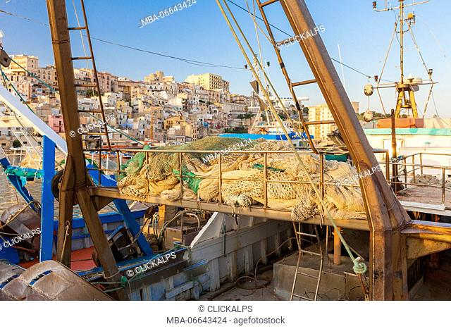 The fishing boats moored in the harbour frame the old town of Sciacca province of Agrigento Sicily Italy Europe