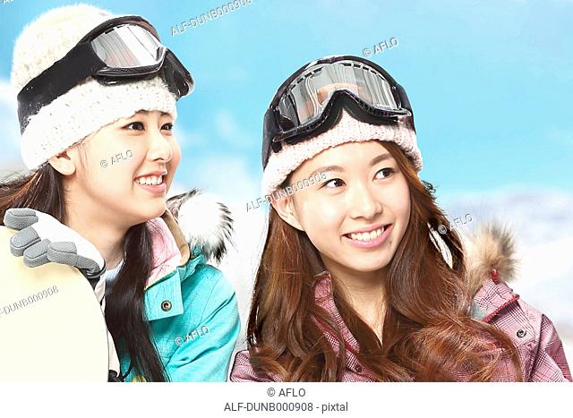 Young Japanese women snowboarding