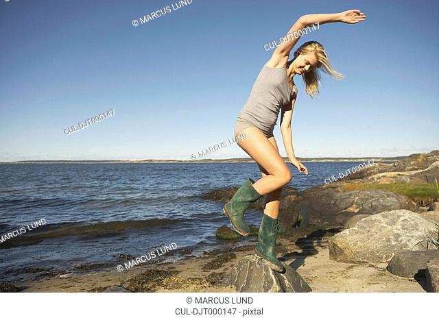Young Woman in Wellingtons