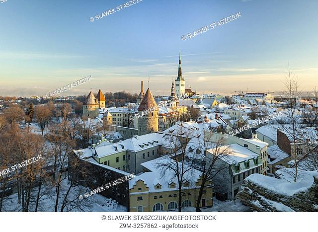Winter sunrise in Tallinn old town, Estonia. St Olaf church dominates towers above the city