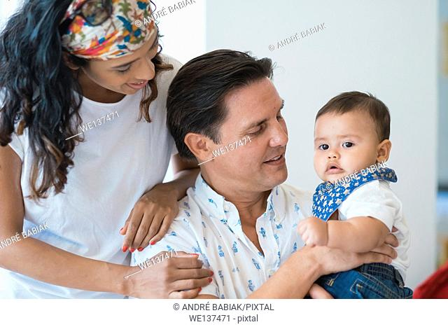 Family of hispanic mother, caucasian father and multi ethnic baby son