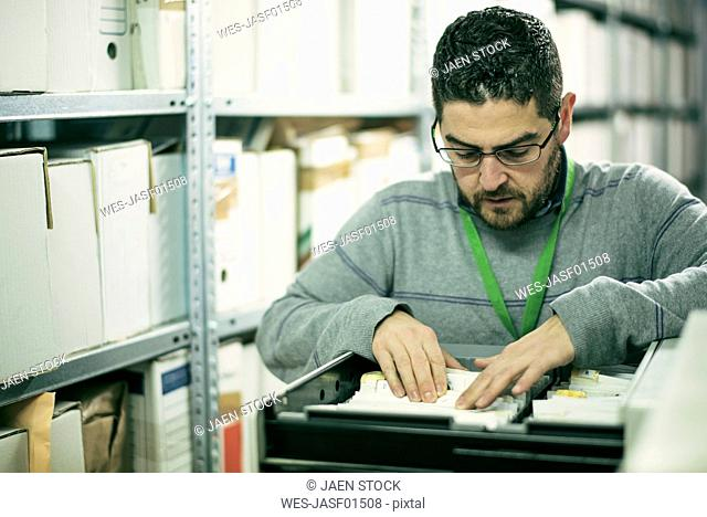 Man searching for files in an archive
