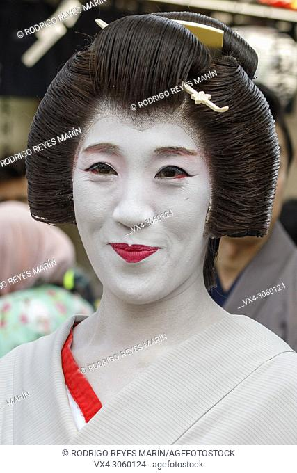 Geishas walk towards Sensoji Temple during the Daigyoretsu or Large Parade of Sanja Matsuri Festival in Asakusa on May 18, 2018, Tokyo, Japan