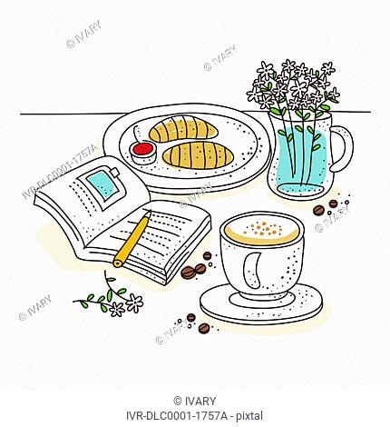Croissant on plate with book and coffee cup