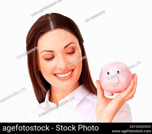 Confident businesswoman holding a piggybank