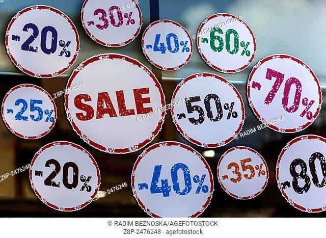 Sale and discounts sign on shop window