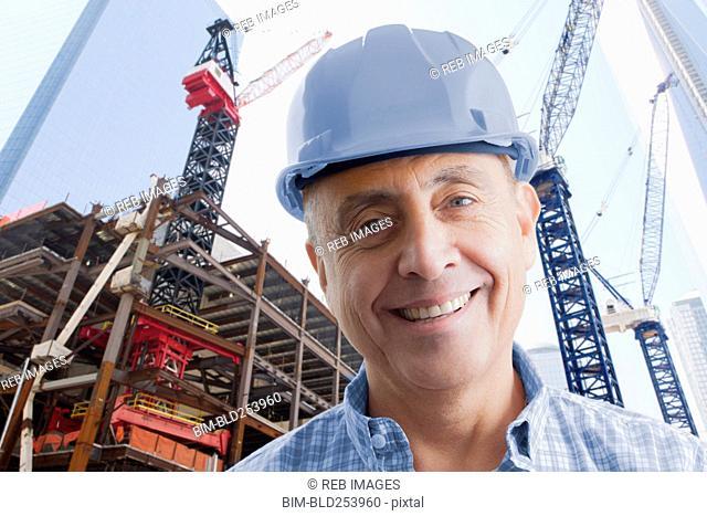 Portrait of smiling Hispanic construction worker