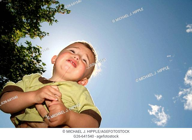 Crying baby against blue sky