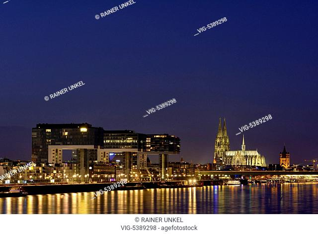 DEU , GERMANY : Panorama of Cologne at Rhine river with Crane buildings , Cathedral and Great St.Martin church , 31.12.2015 - Cologne, Northrhine-Westfalia