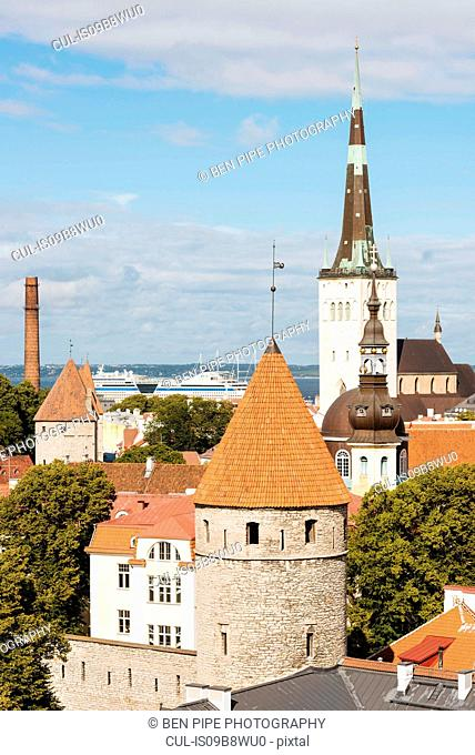 Elevated rooftop cityscape with Viru Gate and bell towers, Tallinn, Estonia