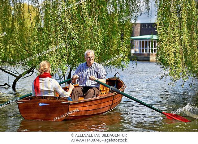 Senior and his daughter riding a rowboat
