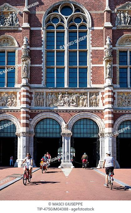 Amsterdam, cyclist leaving the rear facade of the Rijksmuseum