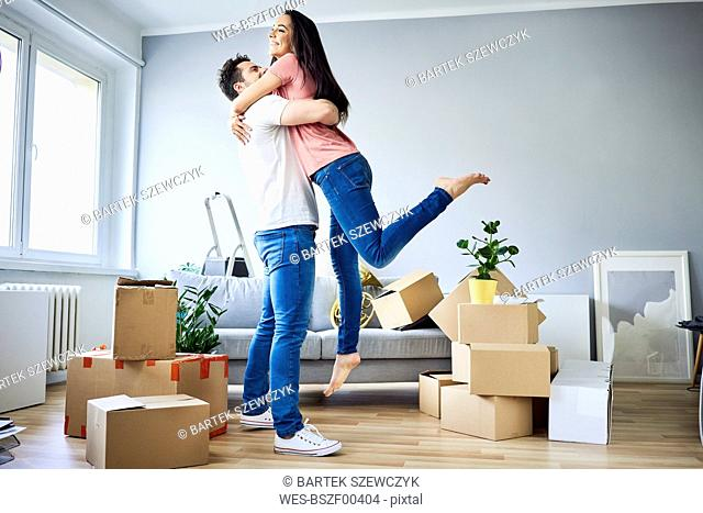 Happy couple celebrating moving in together